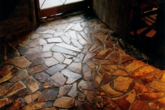 Handcrafted slate tiled floor of the kitchen