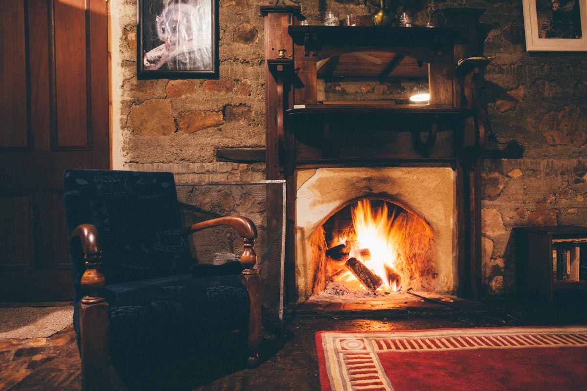 Warmth and glow from the fireplace on a cold winters night